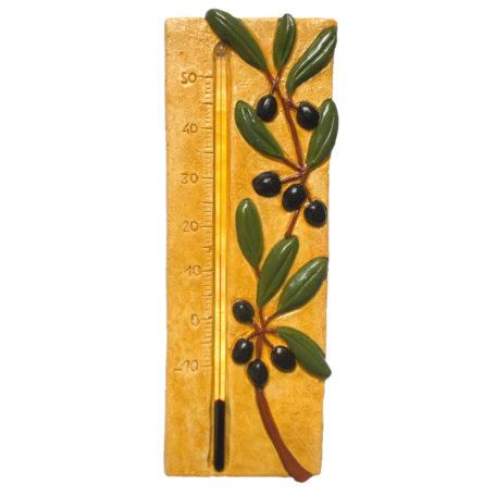 Thermomètre provençal avec des olives sur fond jaune