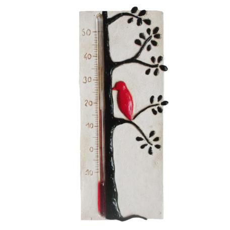 Thermomètre de chambre de bébé avec un oiseau noir