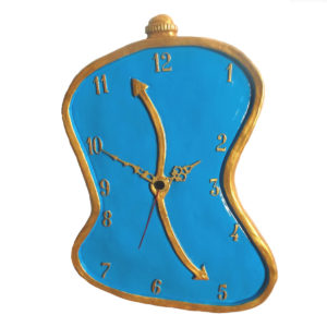 Horloge molle bleu style Dali